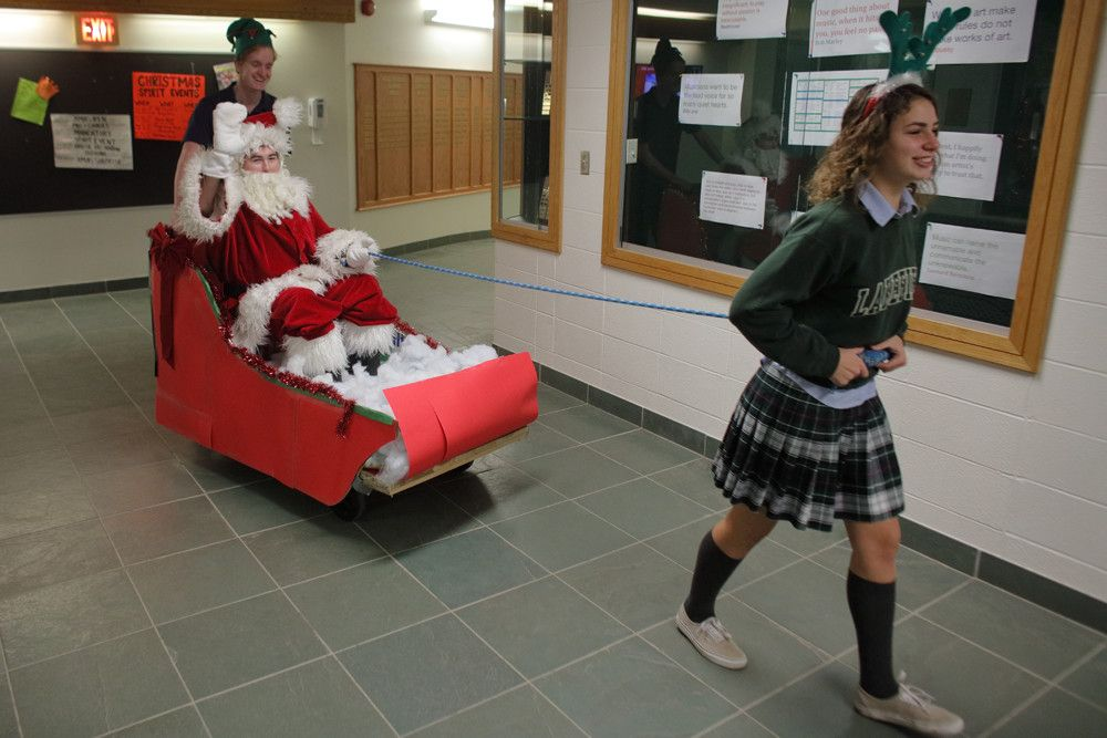 The School Life Class spread holiday cheer and carolled through the hallways and classrooms.