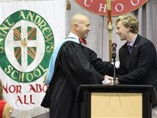 Headmaster Peter B. Benedict II congratulates Senior Reilly Stanton