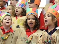 Junior Kindergarten Students singing during the Lower School Thanksgiving Feast